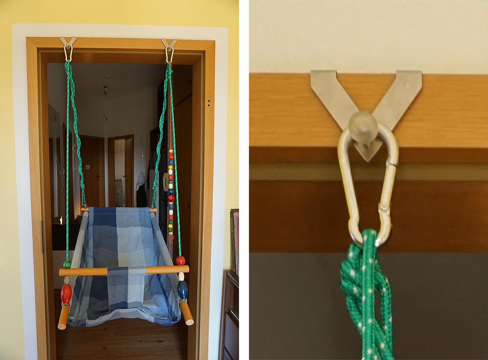 Kinderschaukel in einem Türrahmen aufgehängt